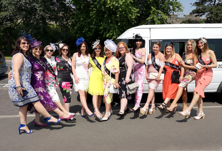Ladies Day at the races – A group ready to enjoy their trip on a 16 seater with Blackpool Minibuses