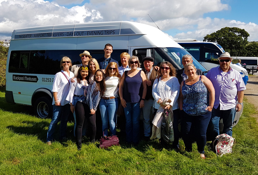 Race Days – A group ready to enjoy their day at the races after a trip on a 16 seater with Blackpool Minibuses